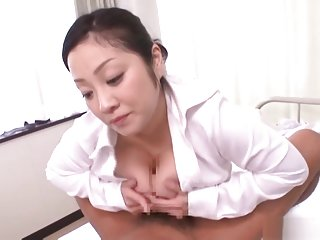 Minako Komukai naughty Asian nurse enjoys patients hard cock