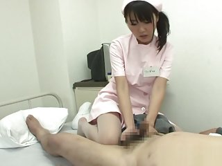 Naughty Asian nurse Tsubomi gives her patient intense anal exam