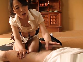 Mature Asian chick shows off talents by giving a blowjob