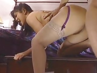 Mika Tan sticks a huge dildo inside her tight pussy then analizes her